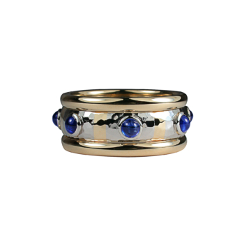 Cabochon blue sapphires in 18K yellow gold and platinum