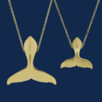 be-jewelled for wild aid handcrafted humpback whale tail pendants handcrafted in 18k yellow gold alexander jewell