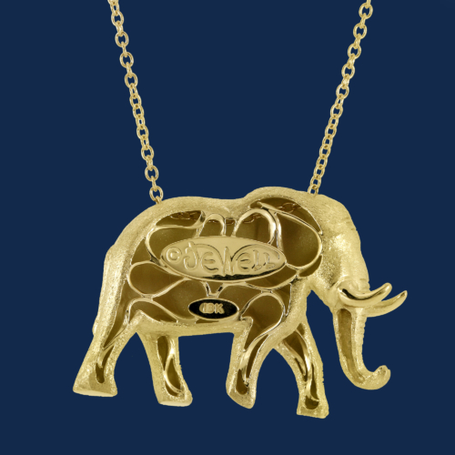 18k gold elephant pendant handcrafted by alexanader jewell for wildaid's endangered species line of luxury jewelry